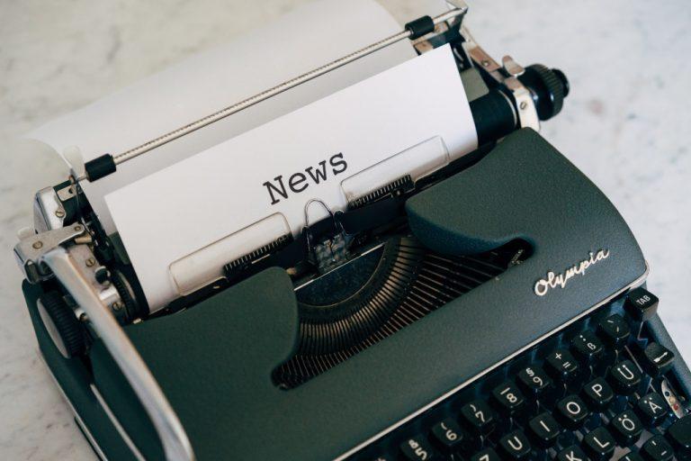 Typewriter with heading 'News'